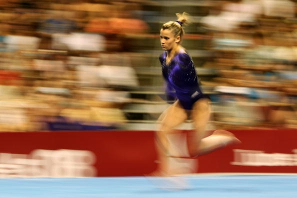 A Gymnasts runs into vault