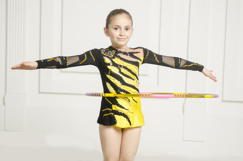 Beautiful girl with Pink Rhythmic gymnastics hoop