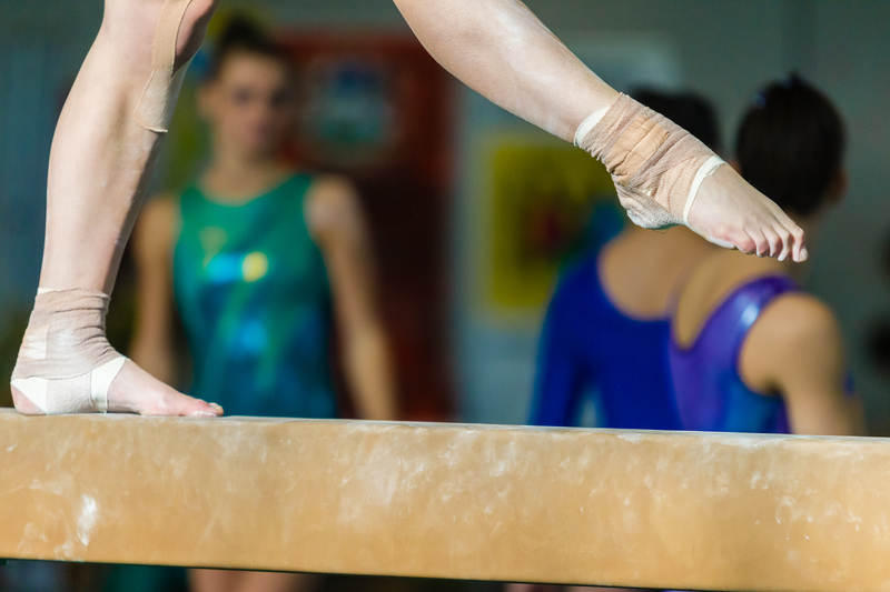 Gymnasts Girl Feet Strapped Beam