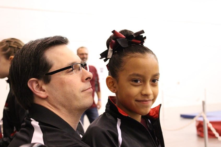 gymnast and her dad