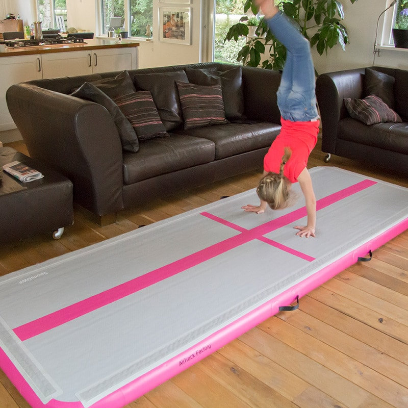 Gymnast doing handstand at home on air track mat. Source: airtrackus.com