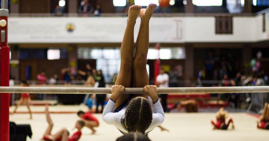 Gymnast practicing on bar