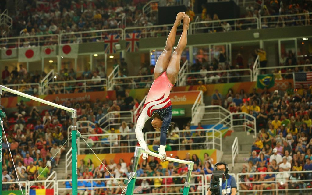 Olympic champion Simone Biles of United States competes on the uneven bars at women's team all-around gymnastics at Rio 2016 Olympic Games at Rio Olympic Arena